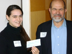 SHARP vice-president, Frank Noto, presents a check for $1,000 from SHARP to Suzanne Rivecca, Development Director, of Homeless Youth Alliance, winners of Reality Grantmaking on April 22, 2014, at The Foundation Center in San Francisco.