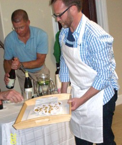Deane Hartley poured the wine while Dan Clark served the mushroom appetizer