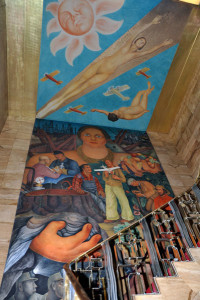 The mural covers the wall and ceiling above the main staircase.